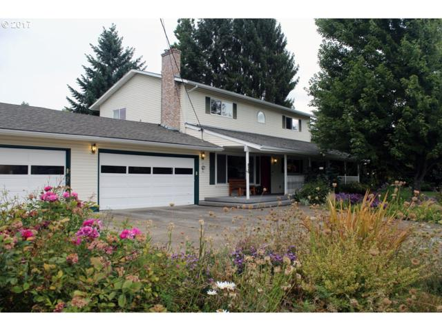 825 NE Queens Ln, Hillsboro, OR 97124 (MLS #17049614) :: Next Home Realty Connection
