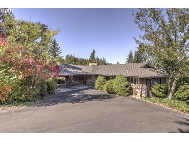 9700 SE Castle Ct, Damascus, OR 97089 (MLS #17145264) :: Matin Real Estate