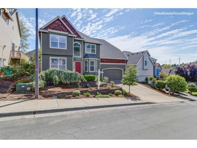 6076 NW 165TH Ter, Portland, OR 97229 (MLS #17249267) :: The Sadle Home Selling Team