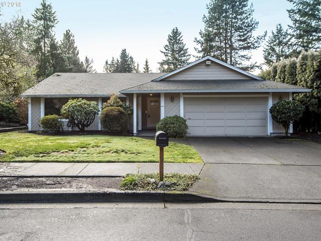 8882 SW Arapaho Rd, Tualatin, OR 97062 (MLS #18024212) :: Hillshire Realty Group
