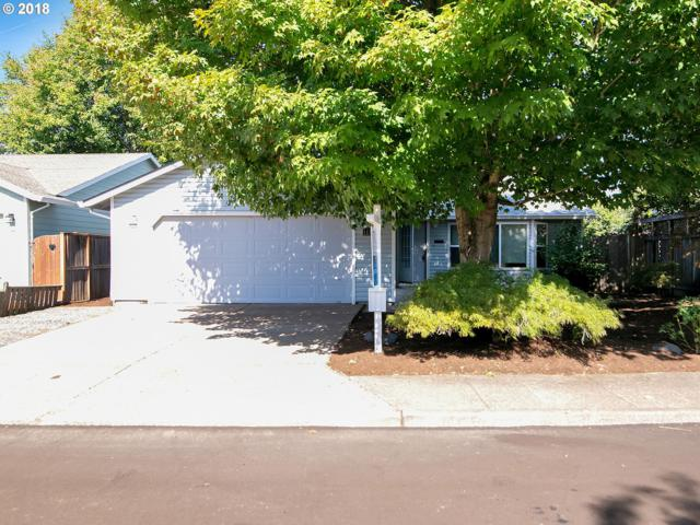 11749 SW Swendon Loop, Tigard, OR 97223 (MLS #18039010) :: The Sadle Home Selling Team