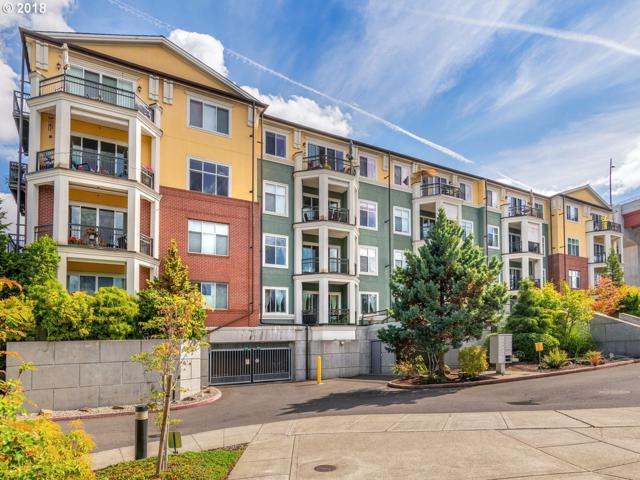 196 SE Spokane St #203, Portland, OR 97202 (MLS #18121075) :: The Sadle Home Selling Team