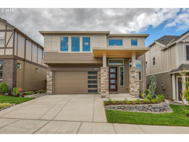 4263 NW Ashbrook Dr, Portland, OR 97229 (MLS #18143121) :: Realty Edge