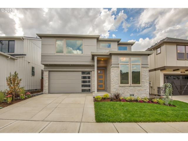 4343 NW Ashbrook Dr, Portland, OR 97229 (MLS #18167978) :: Realty Edge