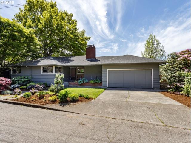 4463 SW Washouga Ave, Portland, OR 97239 (MLS #18181516) :: Team Zebrowski