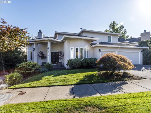 9518 NW Bartholomew Dr, Portland, OR 97229 (MLS #18235151) :: The Sadle Home Selling Team
