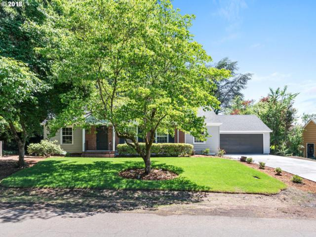 7700 SW Broadmoor Ter, Portland, OR 97225 (MLS #18246264) :: Hatch Homes Group