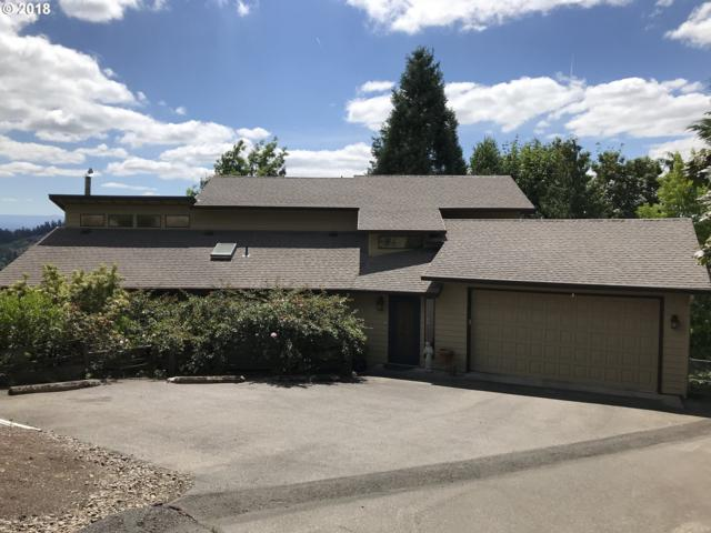 11640 SE Hilltop Ct, Happy Valley, OR 97086 (MLS #18304085) :: Hatch Homes Group