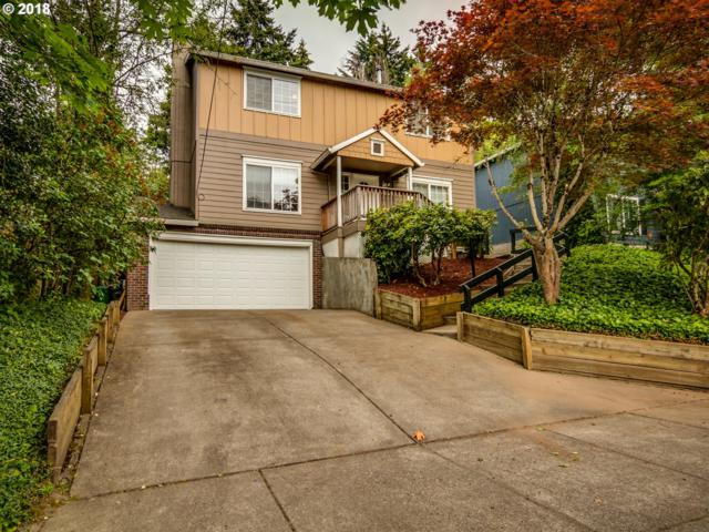 7541 SW View Point Ter, Portland, OR 97219 (MLS #18405564) :: Team Zebrowski