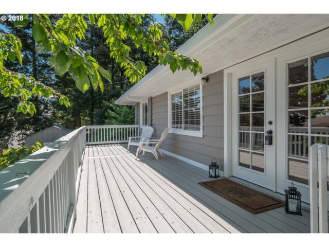 7836 SW Terwilliger Blvd, Portland, OR 97219 (MLS #18504929) :: The Sadle Home Selling Team