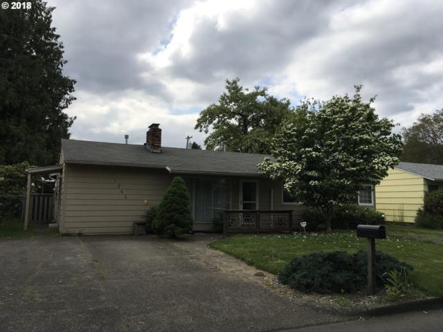 1345 SE 175TH Pl, Portland, OR 97233 (MLS #18596629) :: Team Zebrowski