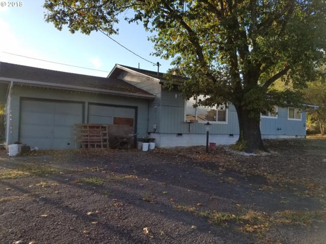 210 NW Glenhart Ave, Winston, OR 97496 (MLS #18645804) :: Premiere Property Group LLC