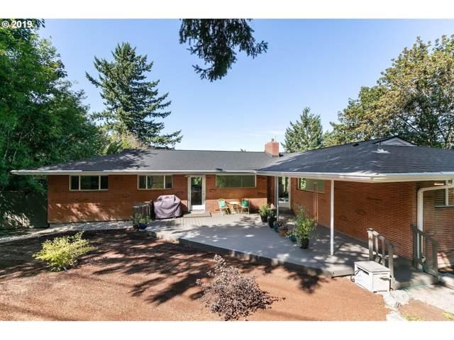 6110 SW Lesser Way, Portland, OR 97219 (MLS #19136519) :: McKillion Real Estate Group