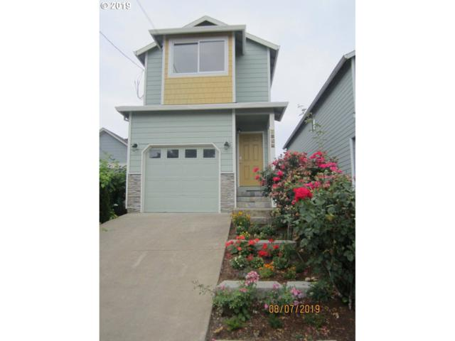 6968 N Columbia Way, Portland, OR 97203 (MLS #19270518) :: Lucido Global Portland Vancouver