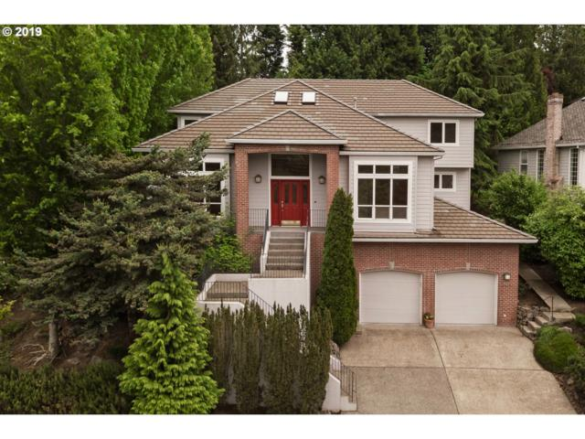 1612 NW Morgan Ln, Portland, OR 97229 (MLS #19402448) :: Townsend Jarvis Group Real Estate