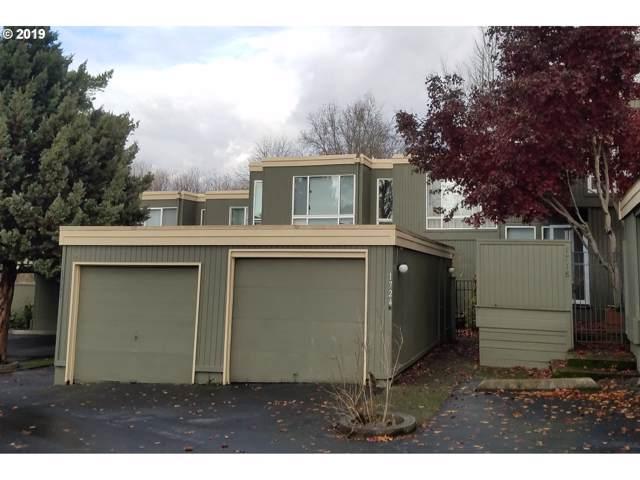 1724 NW Midlake Ln, Beaverton, OR 97006 (MLS #19418778) :: Homehelper Consultants