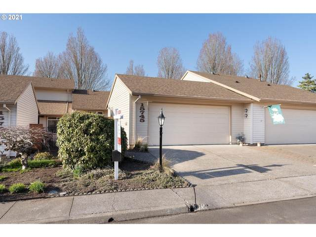 15745 SW Greens Way, Tigard, OR 97224 (MLS #21012857) :: Song Real Estate
