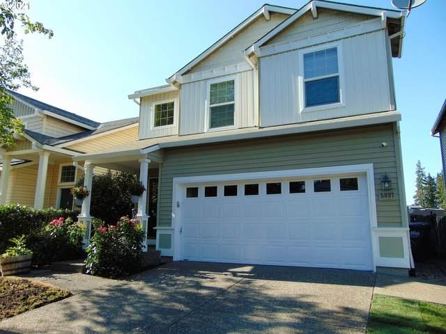 5097 NE Candlewood Pl, Hillsboro, OR 97124 (MLS #21018857) :: Keller Williams Portland Central