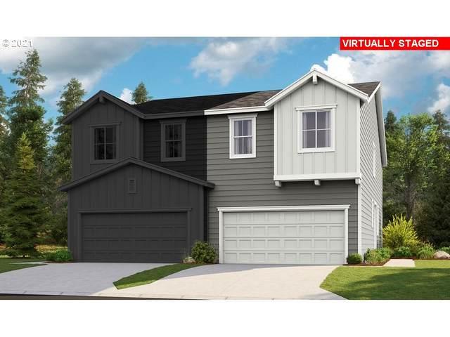 3144 N Pioneer Canyon Dr, Ridgefield, WA 98642 (MLS #21027861) :: McKillion Real Estate Group