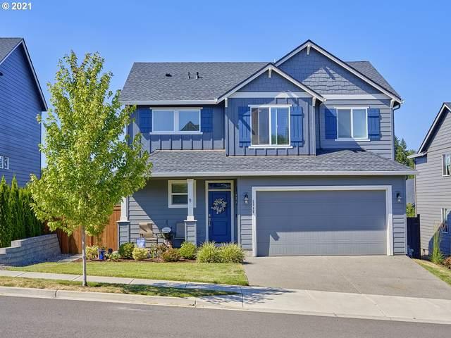 1712 NE 172ND St, Ridgefield, WA 98642 (MLS #21039492) :: McKillion Real Estate Group