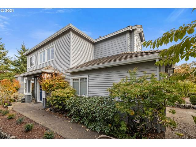 9819 NW Silver Ridge Loop, Portland, OR 97229 (MLS #21043024) :: Real Tour Property Group