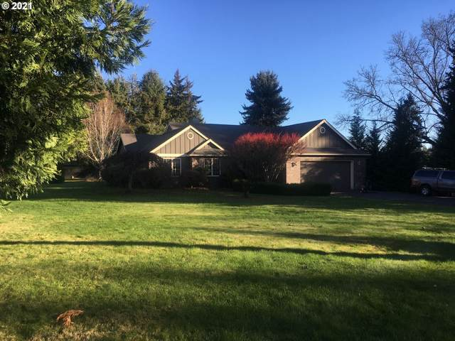 13997 SW River Ln, Tigard, OR 97224 (MLS #21048450) :: Fox Real Estate Group