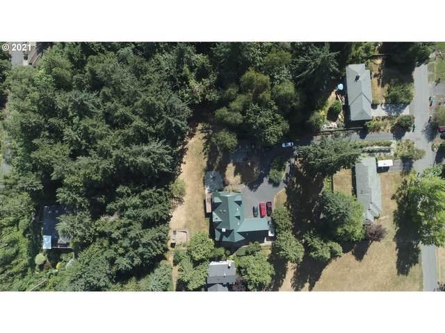 5611 SW Brugger St, Portland, OR 97219 (MLS #21075142) :: Real Estate by Wesley