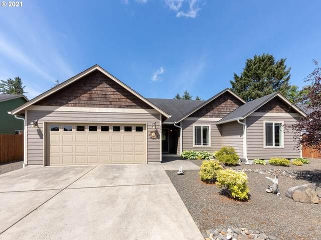 221 SW Kalmia Ave, Warrenton, OR 97146 (MLS #21090132) :: McKillion Real Estate Group
