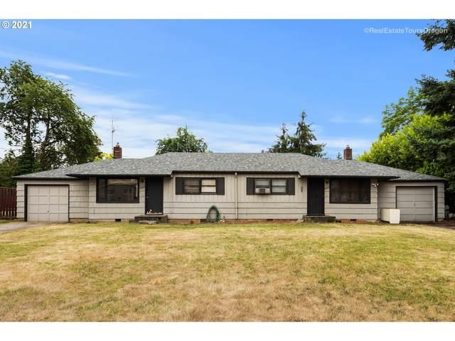 12010 SE Woodward Pl, Portland, OR 97266 (MLS #21113981) :: Beach Loop Realty