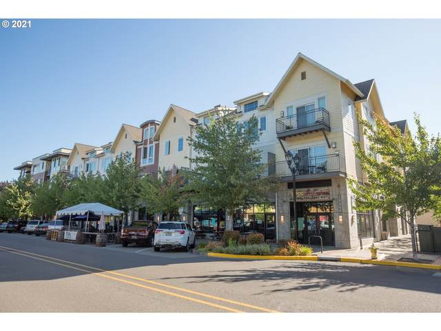 10606 SE Main St #215, Milwaukie, OR 97222 (MLS #21142990) :: Real Tour Property Group