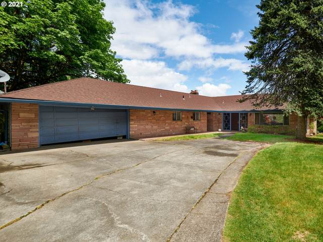 325 NW Royal Blvd, Portland, OR 97210 (MLS #21145124) :: The Pacific Group