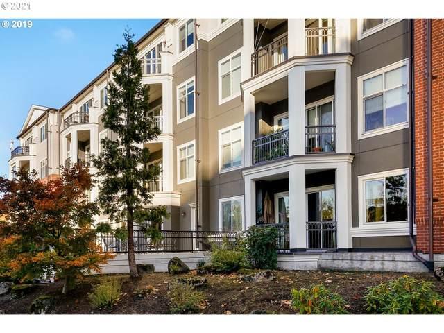 196 SE Spokane St #107, Portland, OR 97202 (MLS #21149068) :: Brantley Christianson Real Estate