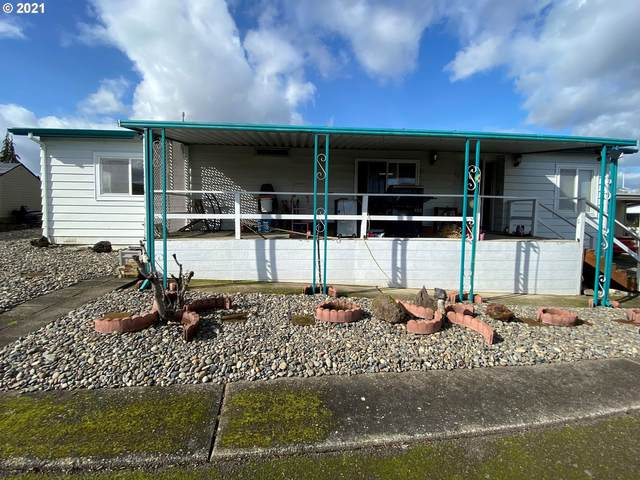 2243 SE River Rd #102, Hillsboro, OR 97123 (MLS #21161939) :: Premiere Property Group LLC