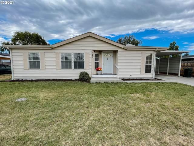 1720 NE 2ND Pl, Hermiston, OR 97838 (MLS #21163202) :: McKillion Real Estate Group
