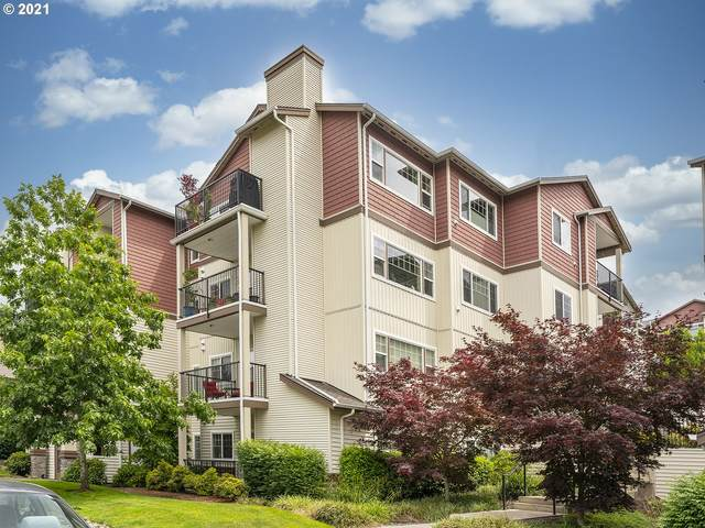 590 NW Lost Springs Ter #402, Portland, OR 97229 (MLS #21179465) :: McKillion Real Estate Group