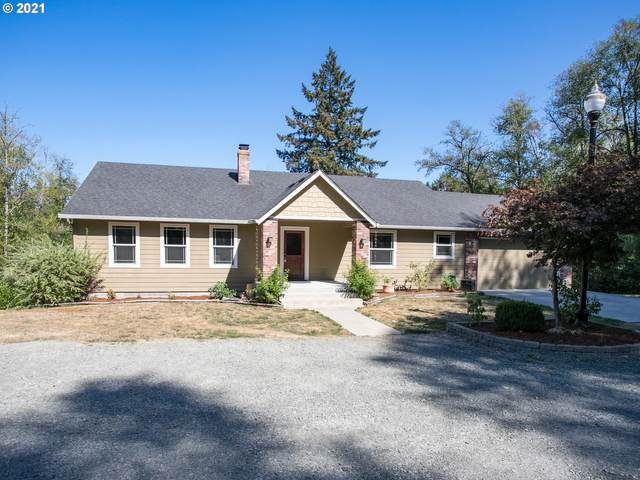1502 NW Chapel Hill Dr, Woodland, WA 98674 (MLS #21202489) :: Song Real Estate