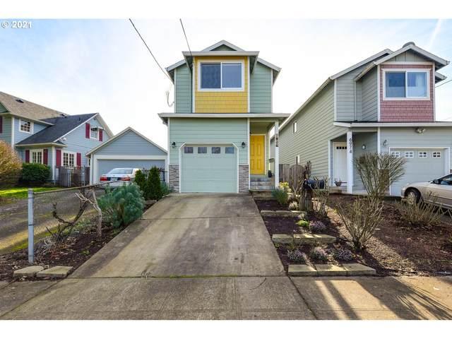6968 N Columbia Way, Portland, OR 97203 (MLS #21226601) :: McKillion Real Estate Group