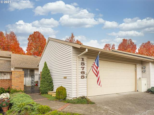 15765 SW Greens Way, Tigard, OR 97224 (MLS #21243153) :: Brantley Christianson Real Estate