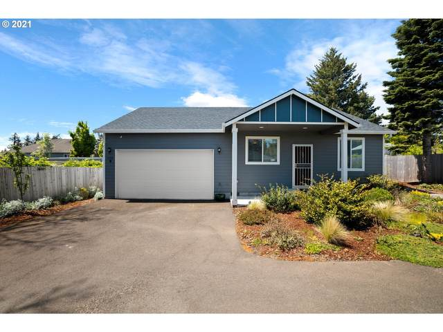105 NE 143RD Ave, Portland, OR 97230 (MLS #21299275) :: Song Real Estate