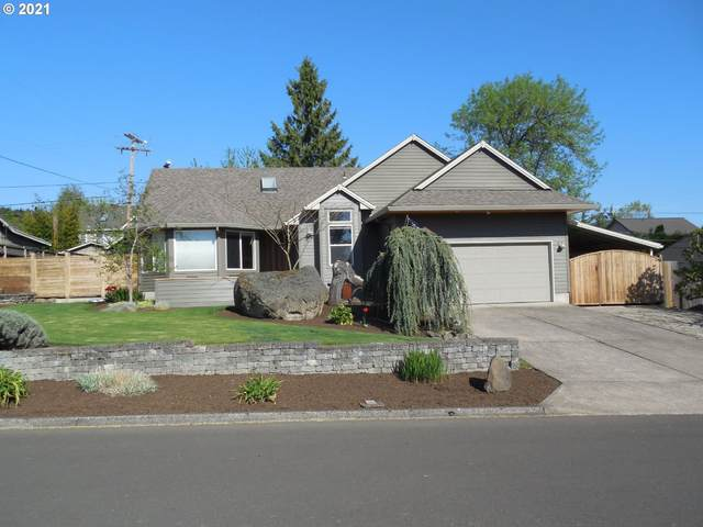 12932 SW 61ST Ave, Portland, OR 97219 (MLS #21342412) :: Townsend Jarvis Group Real Estate