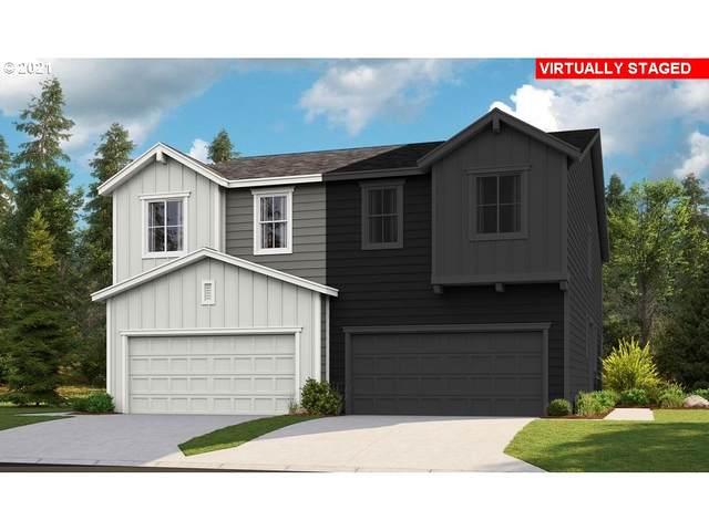 3138 N Pioneer Canyon Dr, Ridgefield, WA 98642 (MLS #21345503) :: McKillion Real Estate Group