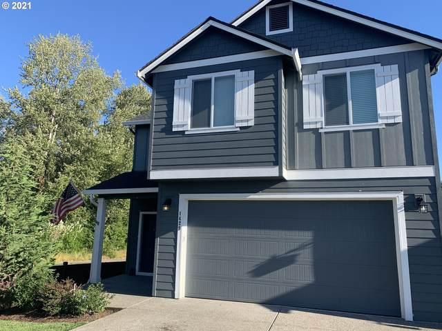 1429 NE 171ST St, Ridgefield, WA 98642 (MLS #21357022) :: McKillion Real Estate Group