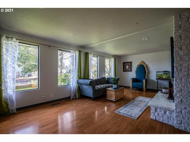 901 NE 6TH Dr, Hillsboro, OR 97124 (MLS #21358144) :: Premiere Property Group LLC