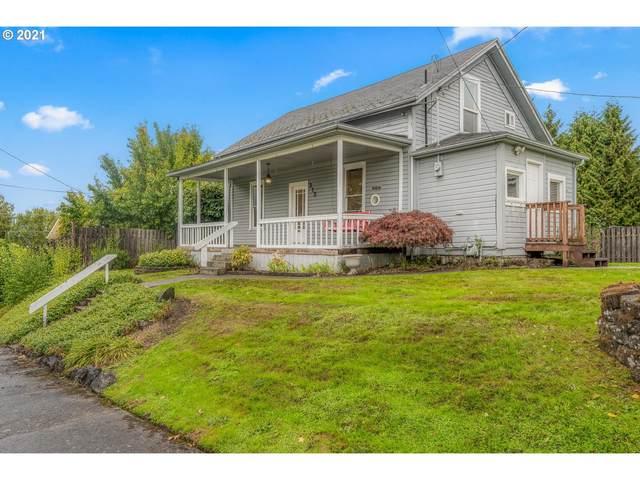 313 E 4TH St, Rainier, OR 97048 (MLS #21376187) :: Holdhusen Real Estate Group