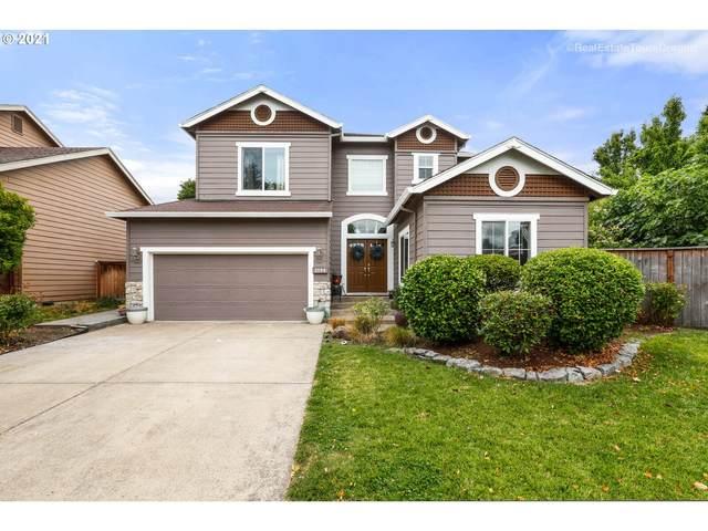 2200 NE 14TH Pl, Hillsboro, OR 97124 (MLS #21376325) :: McKillion Real Estate Group