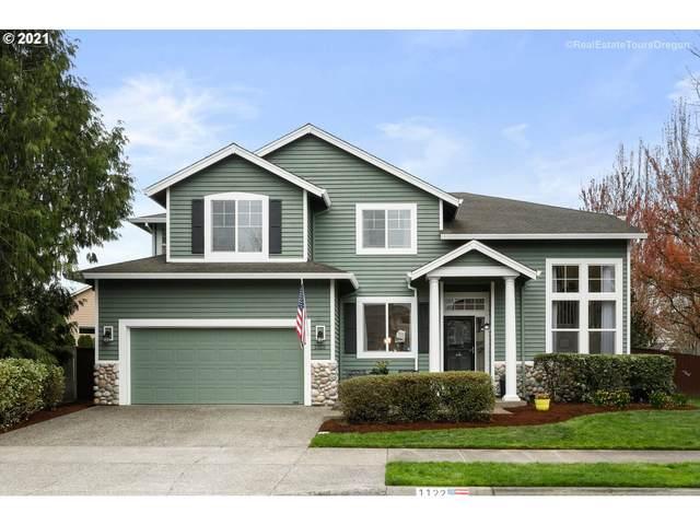 1122 NE Creeksedge Dr, Hillsboro, OR 97124 (MLS #21413838) :: Holdhusen Real Estate Group