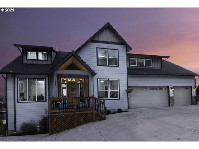 1597 N Columbia Ridge Way, Washougal, WA 98671 (MLS #21422921) :: Real Tour Property Group
