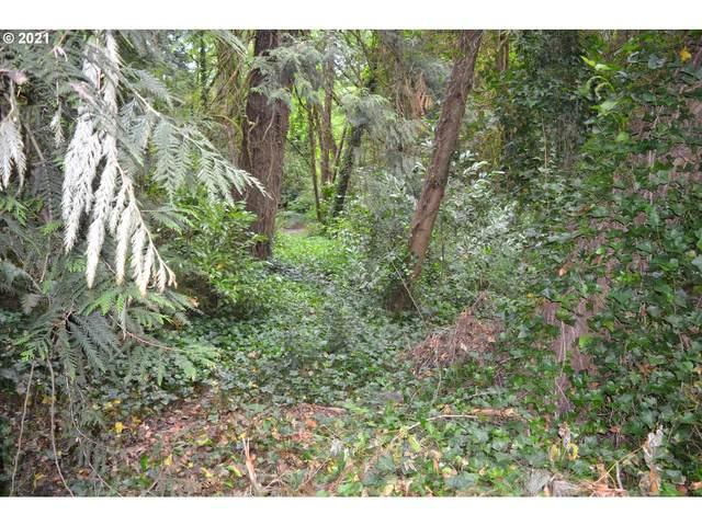 1121 SW Maplecrest Dr, Portland, OR 97219 (MLS #21499079) :: Beach Loop Realty