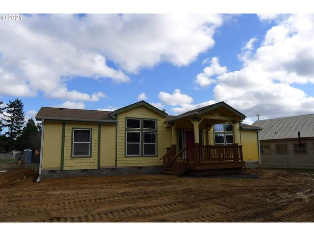 310 N 8TH St, Lakeside, OR 97449 (MLS #21527262) :: McKillion Real Estate Group