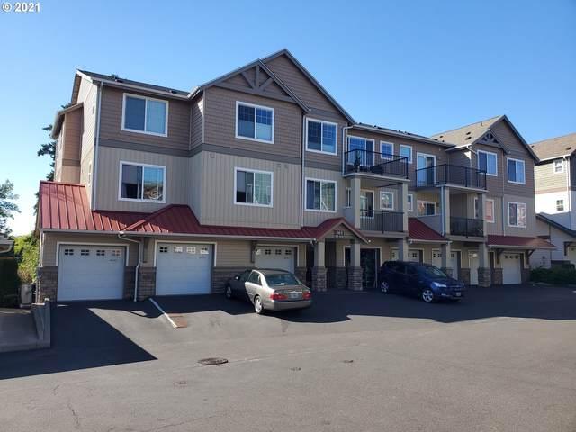 565 NW Lost Springs Ter #102, Portland, OR 97229 (MLS #21532421) :: Holdhusen Real Estate Group